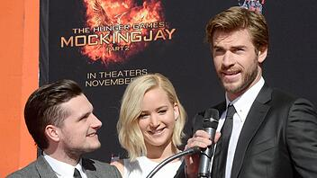 Die Schauspieler Josh Hutcherson, Jennifer Lawrence und Liam Hemsworth (von links nach rechts) in Hollywood/California. Foto: EPA/MIKE NELSON/dpa